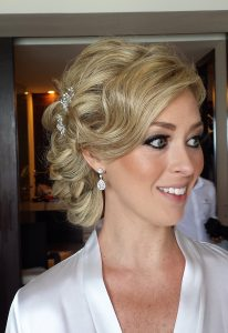 Messy wedding updo in Playa del Carmen by Doranna Wedding Hairstylist & Bridal Makeup Artist