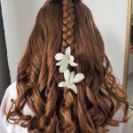 Flower girl braid and curls hairstyle in Cancun, Mexico by Doranna Wedding Hairstylist & Bridal Makeup Artist