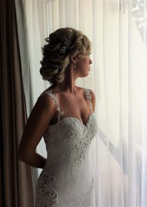 Messy bridal updo in Riviera Maya, Mexico by Doranna Wedding Hairstylist & Bridal Makeup Artist