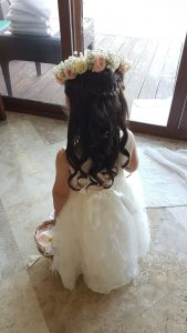 Romantic flower girl hairstyle with floral crown by Doranna Wedding Hairstylist & Bridal Makeup Artist in Mexico