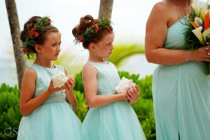 Flower girl updos by Doranna Wedding Hairstylist & Bridal Makeup Artist in Mexico. Photo by Del Sol