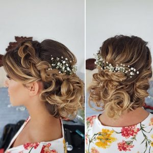 Braided low bun hairstyle by Doranna Wedding Hairstylist & Bridal Makeup Artist in Akumal, Mexico