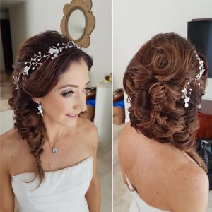 Side swept fishtail with curls for a Dreams Tulum Bride. Doranna Wedding Hairstylist & Bridal Makeup Artist