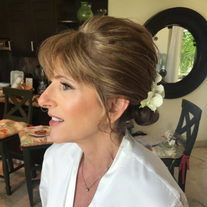Romantic bridal updo by Doranna Wedding Hairstylist & Bridal Makeup Artist in Playa del Carmen, Mexico