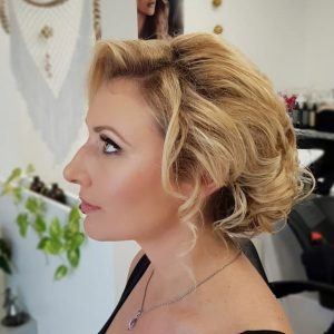 Romantic bridal updo for a beach bride by Doranna Wedding Hairstylist & Bridal Makeup Artist in Playa del Carmen, Mexico