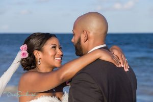Black bride makeup and hair by Doranna Wedding Hairstylist & Bridal Makeup Artist at Dreams Riviera Cancun