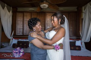 Black mother of the bride makeup at Dreams Riviera Cancun by Doranna Wedding Hairstylist & Bridal Makeup Artist