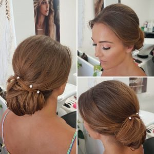 Elegant wedding low bun with rhinestones by Doranna Wedding Hairstylist & Bridal Makeup Artist in Riviera Maya, Mexico