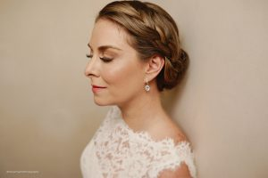 Braided low bun by Doranna Wedding Hairstylist & Bridal Makeup Artist at Papaya Playa Project Tulum
